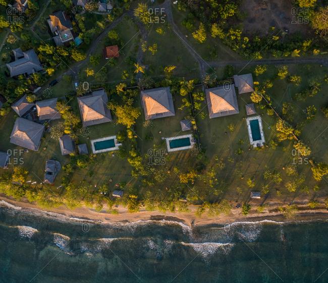 GEROKGAK, BALI - 21 AUGUST 2017: Aerial view of Puri Ganesha Homes with swimming pools by coast, Gerokgak, Bali