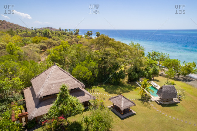 GEROKGAK, BALI - 21 AUGUST 2017: Aerial view of Puri Ganesha individual home with swimming pool by coast, Gerokgak, Bali