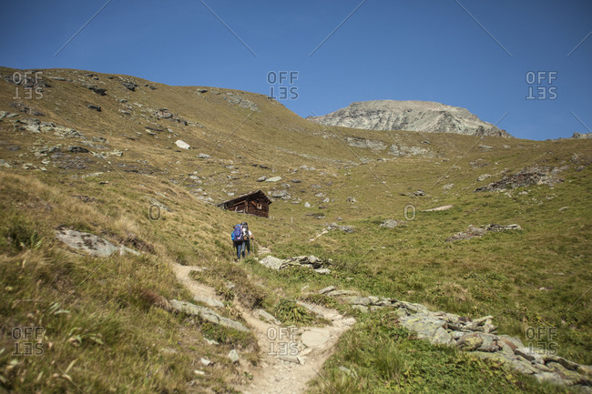 Wanderer in front of mountain landscape, Switzerland alps
