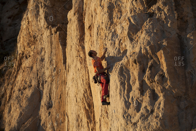Catalonia, Spain - July 28, 2017: Climber in the climbing area Pas de la Mala Dona, Costa del Garraf, Catalonia, Spain