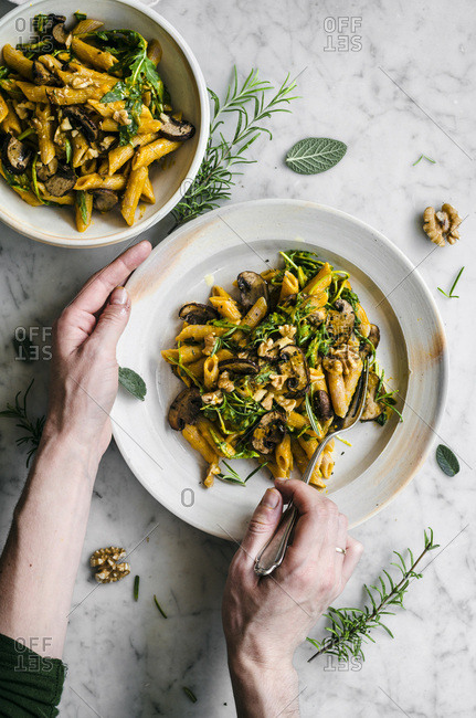 Vegan pumpkin roasted mushroom penne with rucola, walnuts, and herbs
