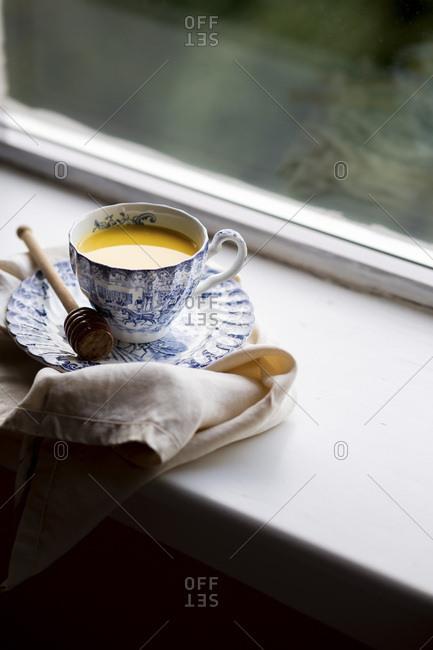 Homemade Turmeric Latte next to a window