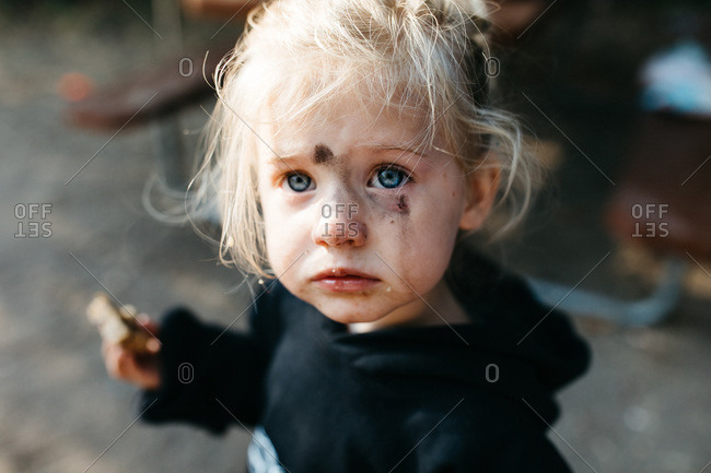 Portrait of a little girl with a dirty face