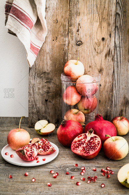 Apples and pomegranates on a wooden table