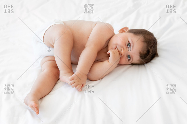 Cute chubby baby on a bed