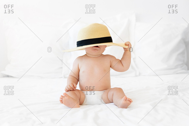 Chubby baby wearing hat