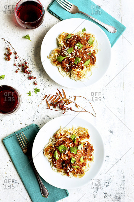 Sun dried tomato spaghetti Bolognese served with red wine