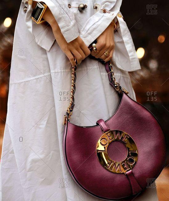 Paris, France - September 21, 2018: Woman carrying designer purse