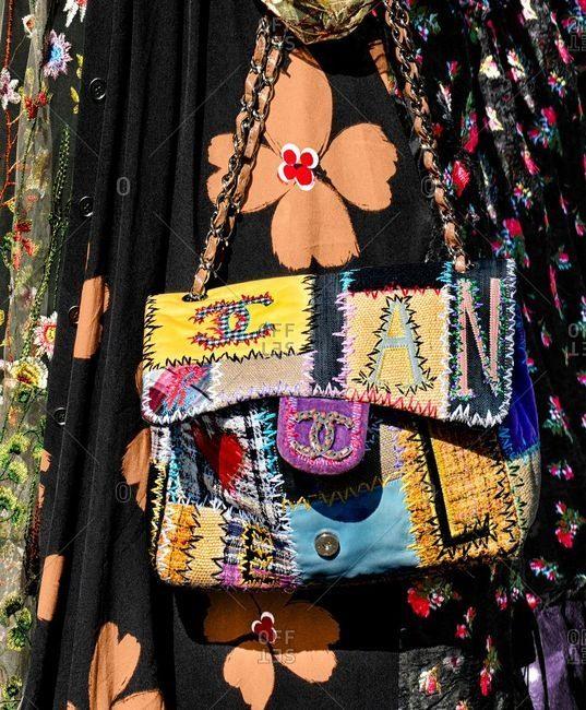 Paris, France - September 21, 2018: Woman carrying designer patchwork purse