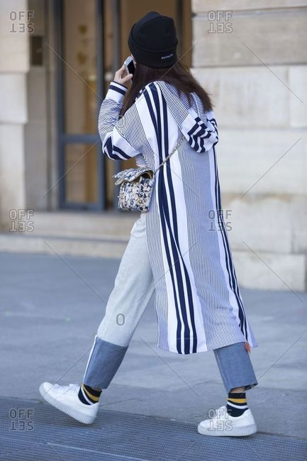 Paris, France - September 21, 2018: Woman walking down street in stylish outfit during Fashion Week