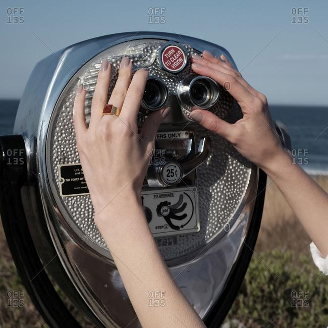 Woman preparing to look through viewfinder