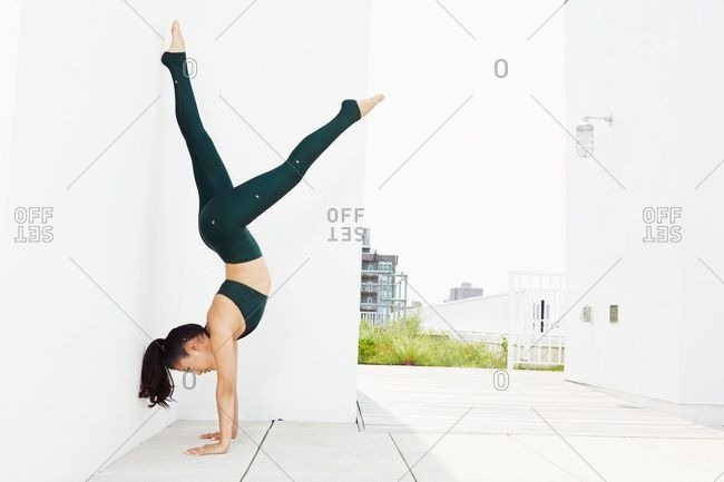 July 1, 2018: Young woman doing handstand