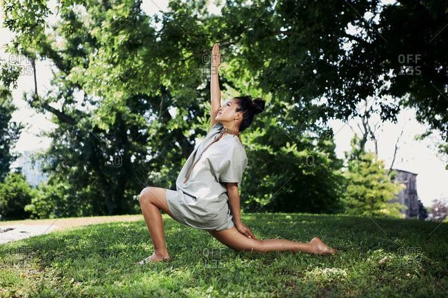 June 30, 2018: Young woman doing yoga in the park