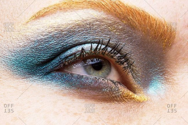 Close up of woman wearing shimmery eye shadow