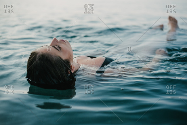 Woman relaxing in a calm sea water