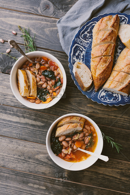 Homemade autumn harvest soup served with baguette