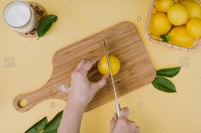 Person doing a how-to for preserving lemons