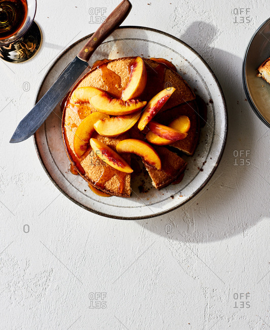 Cast Iron Pan of Buttermilk Cornmeal Cake with Sauteed peaches