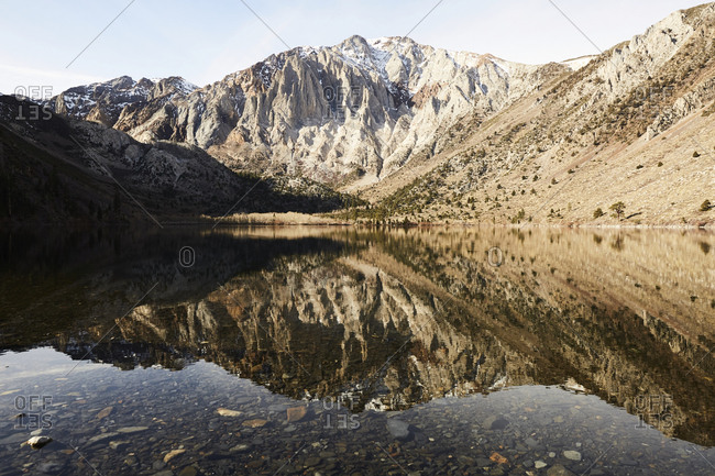 Scenic view of mountains reflected in Convict Lake in the Eastern Sierras