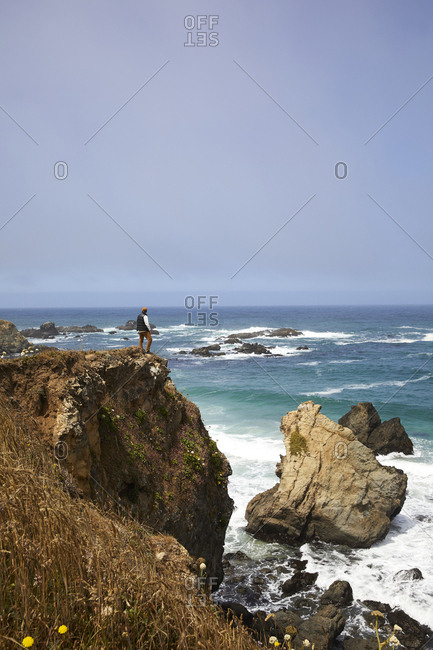 Man standing at scenic overlook on cliff along the Northern California coast