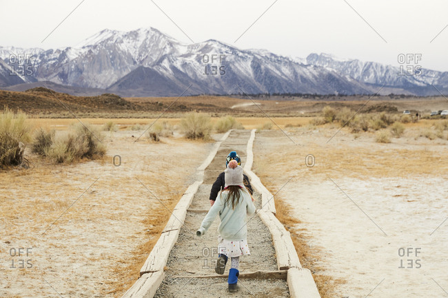 Children walking on hiking path in the Eastern Sierras of California