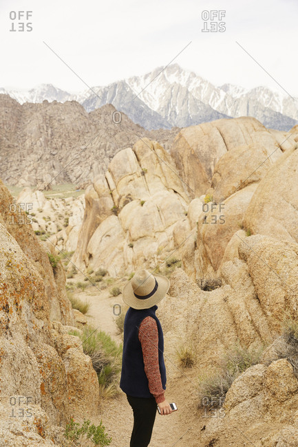 Woman hiking in the Alabama hills in the Eastern Sierras