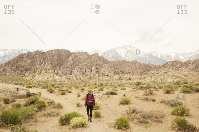 Rear view of woman hiking in the Alabama hills in the Eastern Sierras