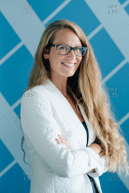 Portrait of young business woman with long blonde hair and glasses