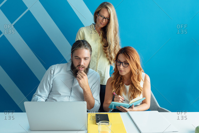 Three coworkers working together in office