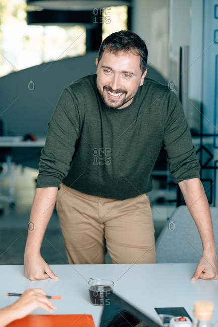 Man standing in office smiling