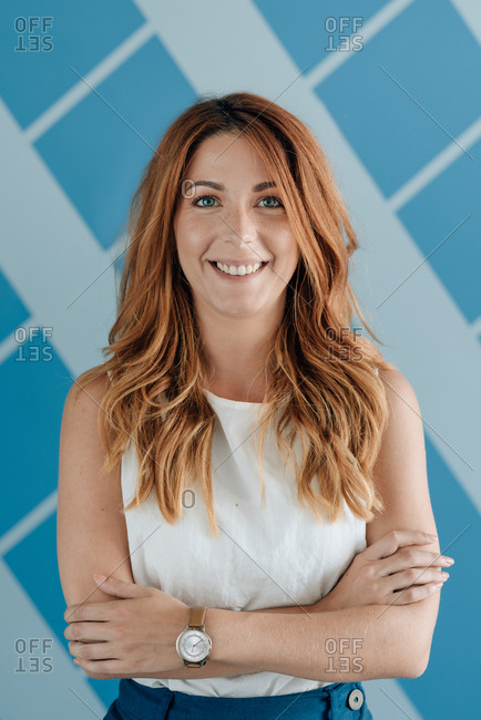 Portrait of a smiling young business woman with red hair