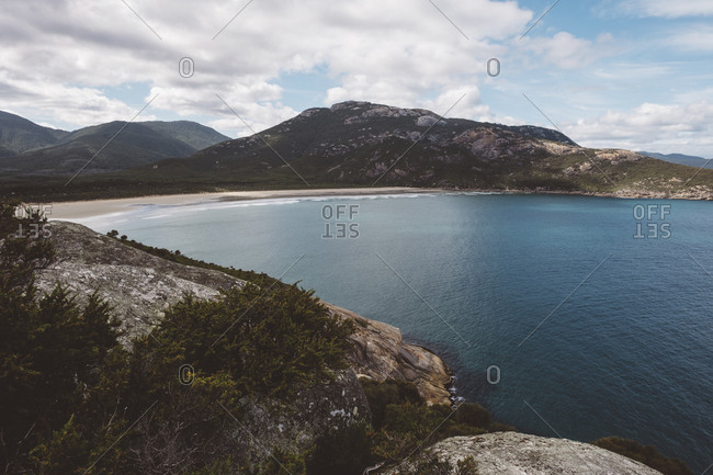 Scenic view of mountains by sea against cloudy sky at Wilsons Promontory National Park