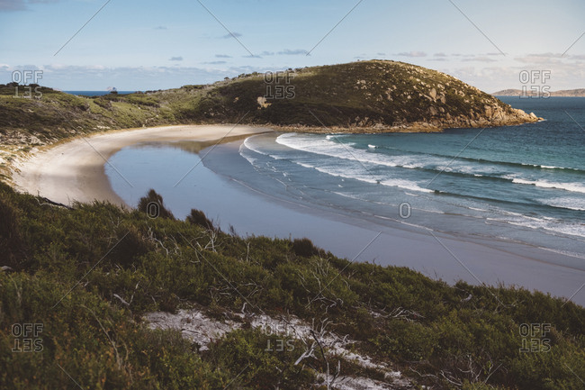 Scenic view of sea by mountains against sky at Wilsons Promontory National Park