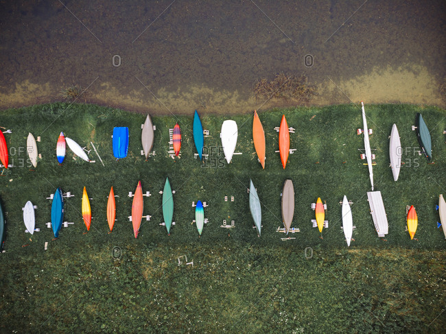 Aerial view of colorful boats moored at harbor by lake