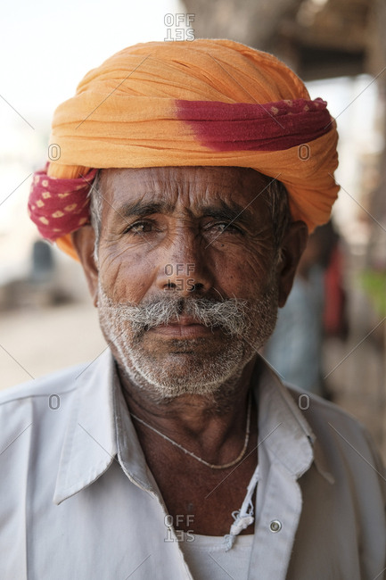 India, Rajasthan, Jaisalmer - November 14, 2016: Close-up portrait of senior man wearing turban outdoors