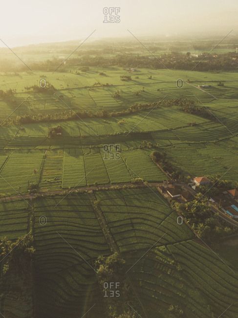 Aerial view of rural landscape against sky during sunrise