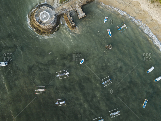 Aerial view of Outriggers moored on sea