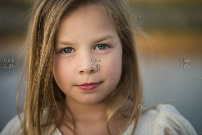 Portrait of cute girl with blue eyes