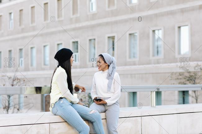 Two Muslim women talking on the street