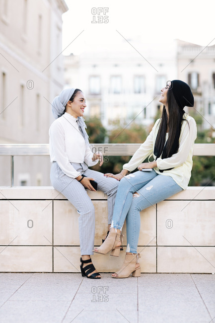 Young couple of Muslim women talking on the street