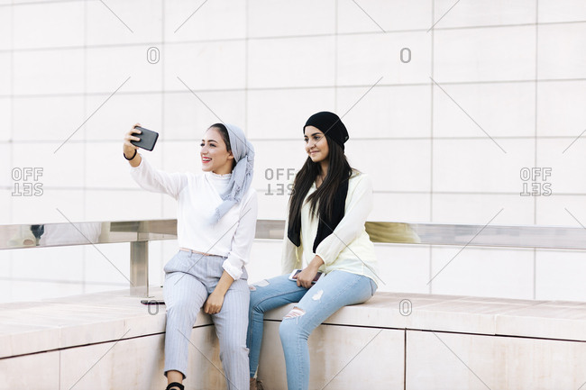 Young couple of Muslim women taking selfies