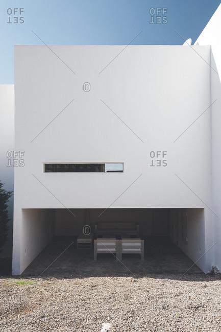 Furniture underneath white building on Mediterranean island