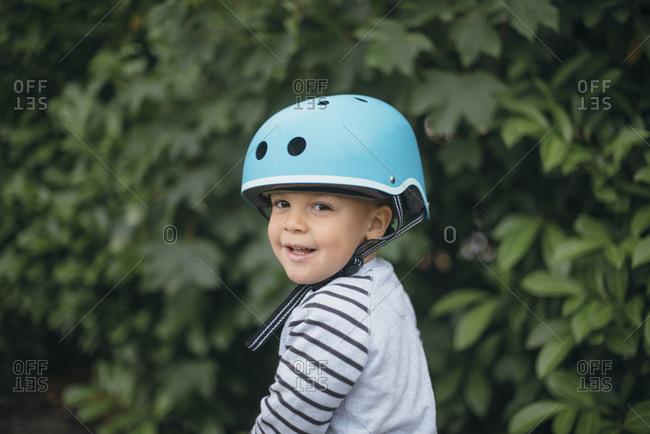 Portrait of a toddler boy wearing blue helmet