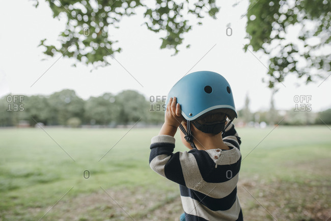 Toddler boy wearing blue helmet