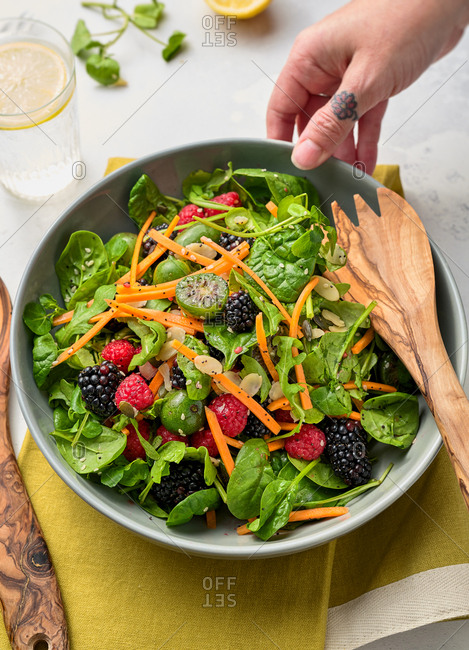 Delicious healthy salad with kiwi berries