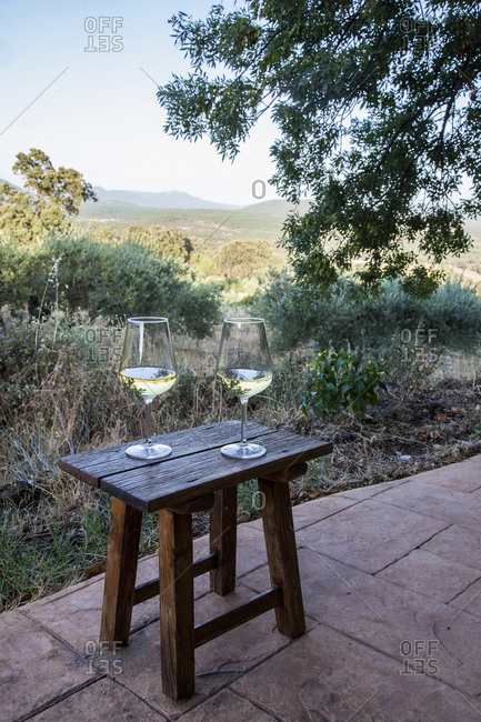 Two glasses of wine on stool in the Gredos mountains, Spain