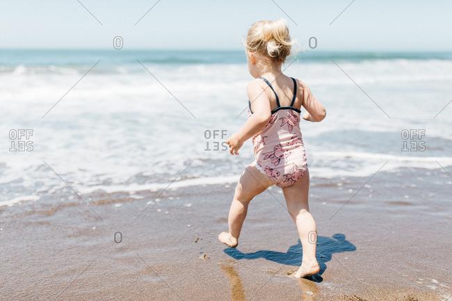 Little blonde girl on Rodeo Beach, California