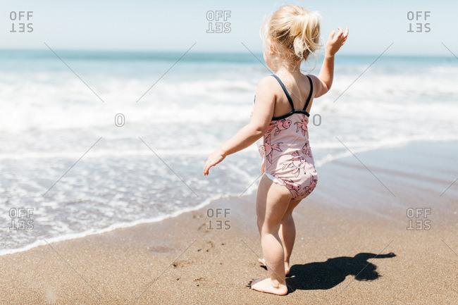 Blonde girl on Rodeo Beach, California