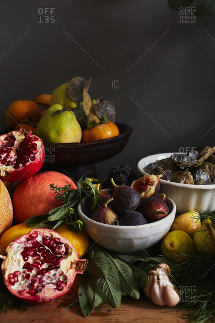 Variety of fresh autumn fruit, herbs, and seafood