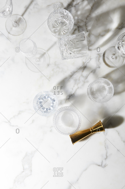 Empty drinking glasses on marble background